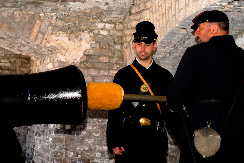 Reenactor Private Bob Wolfhope watches as Private Joel Hummel sponges the canon at Ft. Sumter, located in Charleston Harbor, in Charleston, South Carolina on Wednesday, April 13, 2011. ..The 150th Anniversary of the Firing on Ft. Sumter was commemorated with lectures, performances, demonstrations, and a living history throughout the area on James Island, Charleston, Mt. Pleasant, and Sullivan's Island during the week from April 8-14, 2011. Photo Copyright 2011 Jason Barnette