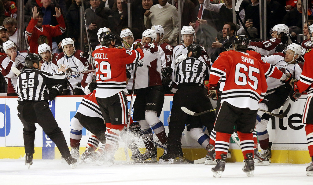. A scuffle breaks out between the Chicago Blackhawks and the Colorado Avalanche in front of the Avalanche bench during the first period of an NHL hockey game, Wednesday, March 6, 2013, in Chicago. (AP Photo/Charles Rex Arbogast)