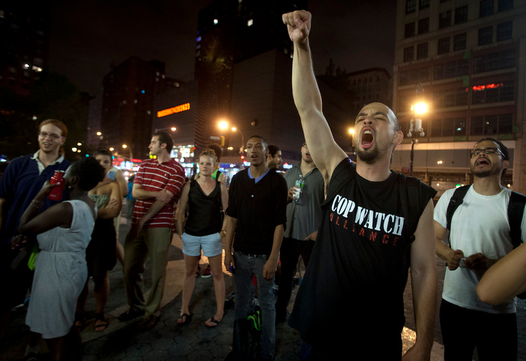 . A man screams during a demonstration in Union Square after the news that George Zimmerman was found not guilty in the 2012 shooting death of teenager Trayvon Martin on Saturday, July 13, 2013 in New York. (AP Photo/Carlo Allegri)