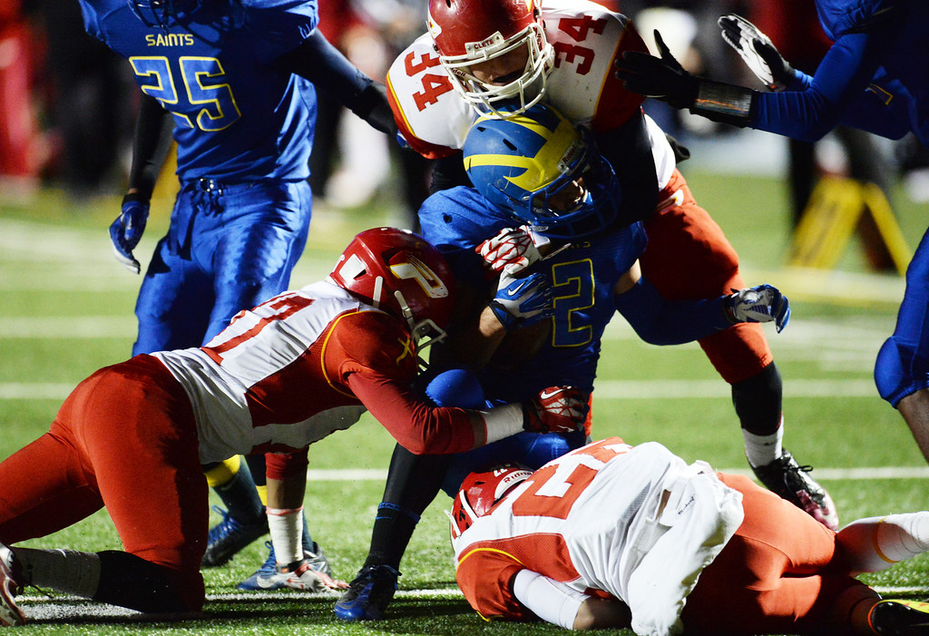 . Paraclete defense tackles San Dimas\' Mitchell Giles (2) in the first half of a CIF-SS Mid-Valley Division championship football game at San Dimas High School in San Dimas, Calif., on Friday, Dec. 6, 2013.   (Keith Birmingham Pasadena Star-News)