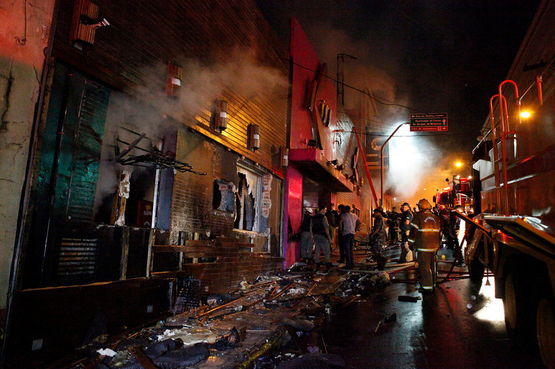 . Firefighters work to douse a fire at the Kiss Club in Santa Maria city, Rio Grande do Sul state, Brazil, Sunday, Jan. 27, 2013. Firefighters say that the death toll from a fire that swept through a crowded nightclub in southern Brazil has risen to 180. Officials say the fire broke out at the club while a band was performing. At least 200 people were also injured. (AP Photo/Agencia RBS)