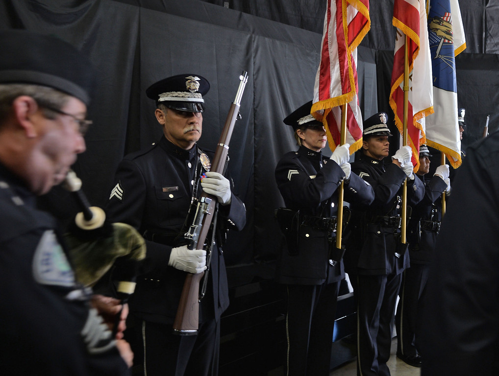 . The Los Angeles Police Protective League and the Eagle & Badge Foundation unveiled new End of Watch Memorial Wall featuring the names of the 206 officers who have died in the line of duty. The 60 ft. wide and 9 ft tall wall was made at Commemorative Badge Company in Gardena where it was unveiled. Color Guard begin ceremony.       Photo by Robert Casillas / Daily Breeze