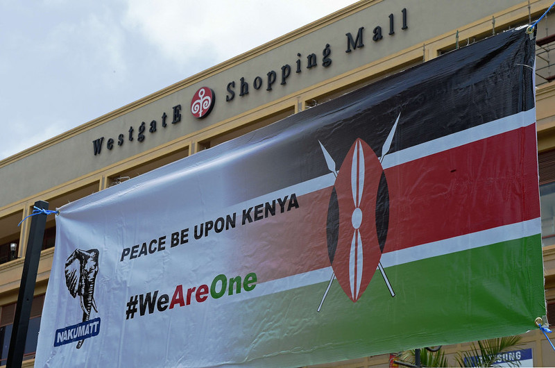 . A banner is seen during a memorial ceremony marking the first anniversary of the Westgate terrorist attack, outside the Westgate mall in Nairobi on September 21, 2014. At least 67 people were killed and scores wounded when a small group of Al-Qaeda affiliated fighters stormed the Westgate mall on September 21 2013. CARL DE SOUZA/AFP/Getty Images