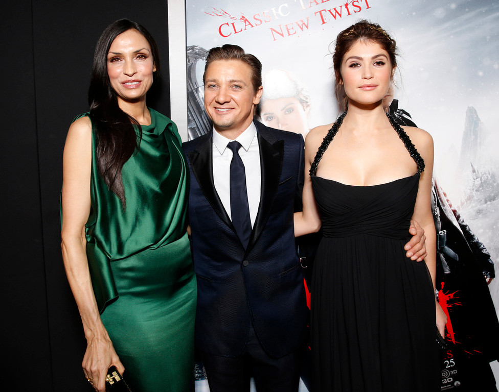 """. Famke Janssen, Jeremy Renner and Gemma Arterton arrive at the premiere of \""""Hansel & Gretel Witch Hunters\"""" on Thursday Jan. 24, 2013, in Los Angeles.  (Photo by Todd Williamson/Invision/AP)"""
