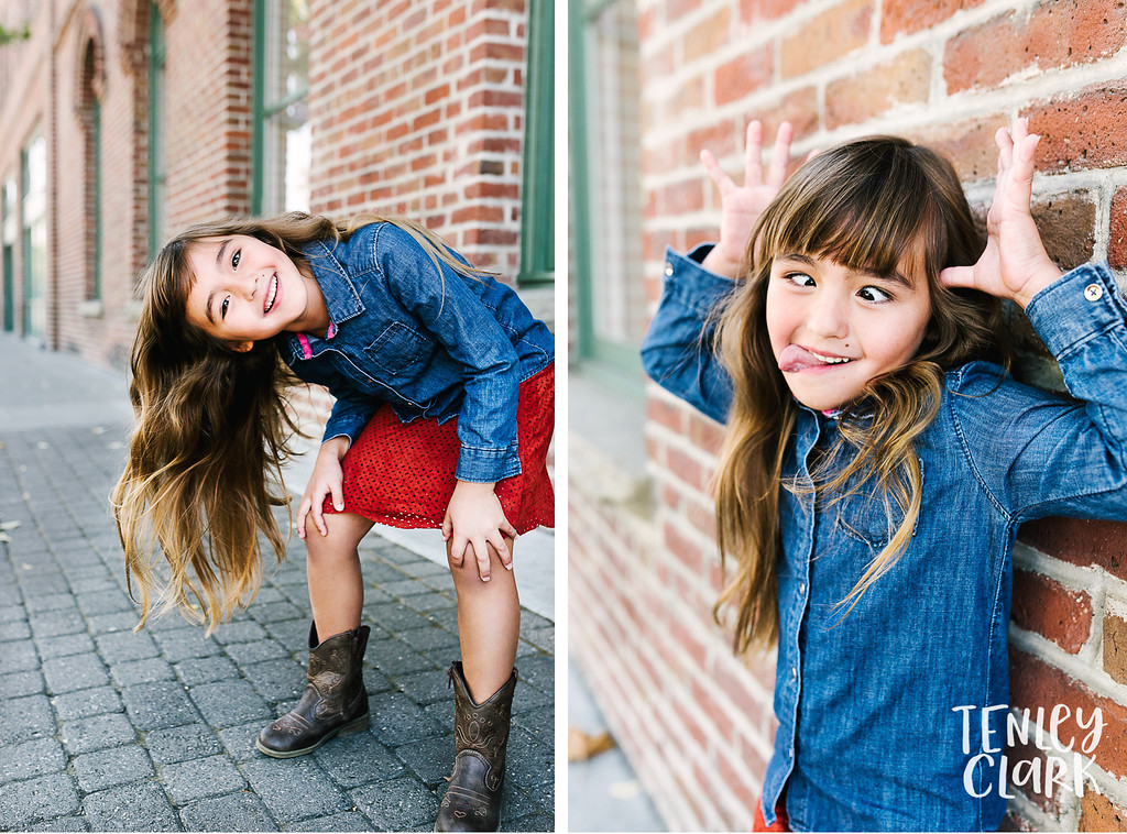 Downtown Pleasanton, CA kids model headshots for JE Model by Tenley Clark Photography. Girl being silly in front of brick walls.