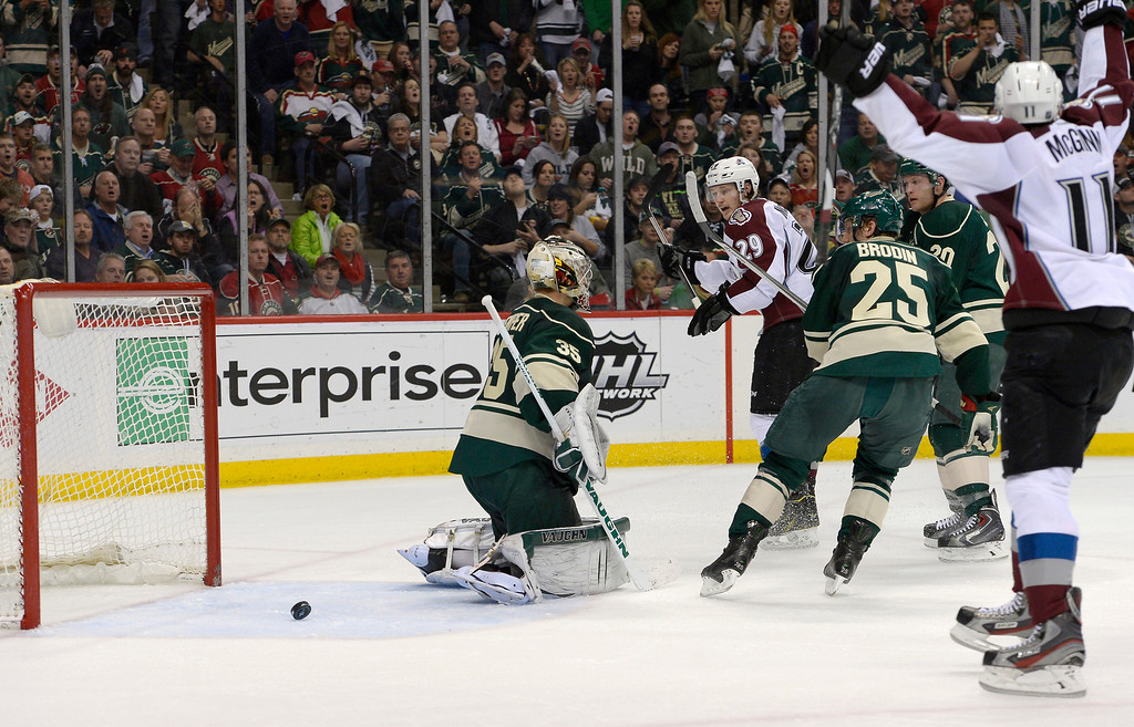 . Colorado Avalanche left wing Jamie McGinn (11) and Colorado Avalanche center Nathan MacKinnon (29) celebrate a goal by Colorado Avalanche center Ryan O\'Reilly (90) during the second period on Minnesota Wild goalie Darcy Kuemper (35) April 24, 2014 in Game 4 of the Stanley Cup Playoffs at Xcel Energy Center. (Photo by John Leyba/The Denver Post)