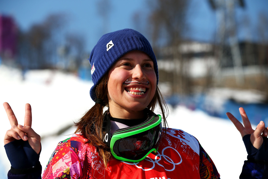 . Gold medalist Eva Samkova of the Czech Republic celebrates during the flower ceremony for the Ladies\' Snowboard Cross Finals on day nine of the Sochi 2014 Winter Olympics at Rosa Khutor Extreme Park on February 16, 2014 in Sochi, Russia.  (Photo by Cameron Spencer/Getty Images)