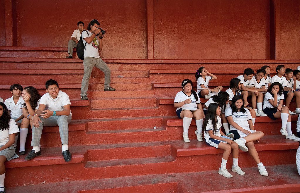 . Mexican journalists are under siege throughout the country both from organized crime and abusive government authorities. Reporters and photographers at El Sur newspaper in Acapulco take various precautions to deal with the threats they receive. Carlos Carbajal, a photographer at El Sur newspaper in Acapulco, on a daily assignment at a high school, covers volunteer teachers giving classes due to a teacher\'s strike in the city. (Keith Dannemiller/MCT)