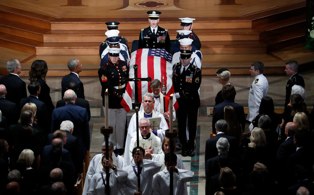 . The casket of Sen. John McCain, R-Ariz., is carried during the recessional at the end of a memorial service at Washington National Cathedral in Washington, Saturday, Sept. 1, 2018. McCain died Aug. 25, from brain cancer at age 81. (AP Photo/Pablo Martinez Monsivais)