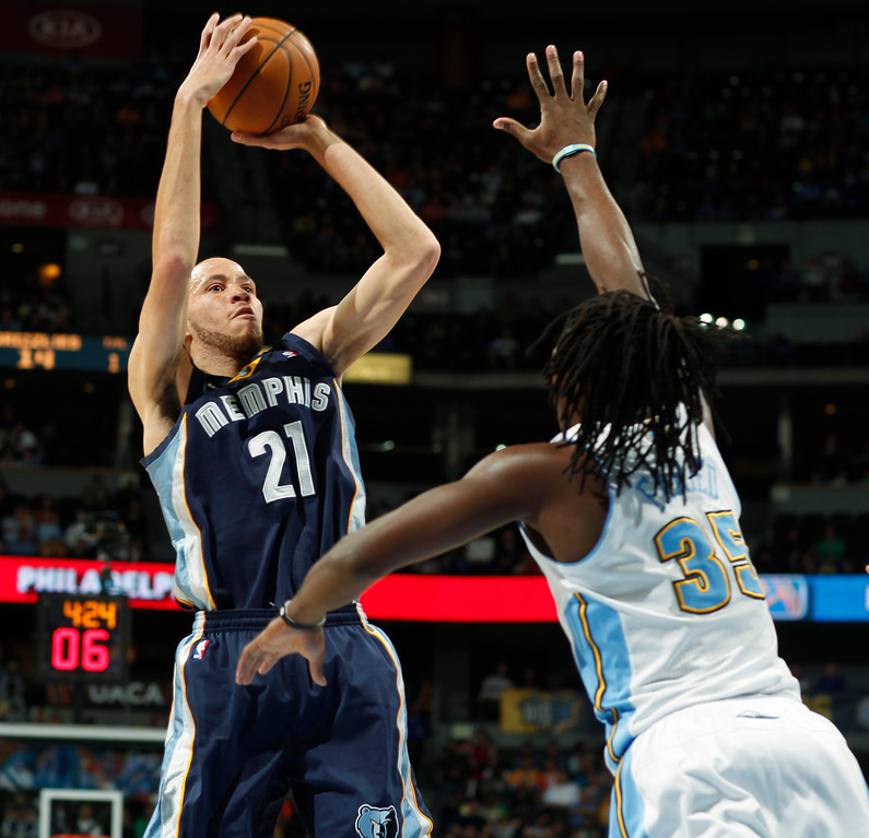 . Memphis Grizzlies forward Tayshaun Prince, left, shoots over Denver Nuggets forward Kenneth Faried in the first quarter of an NBA basketball game in Denver, Friday, March 15, 2013. (AP Photo/David Zalubowski)