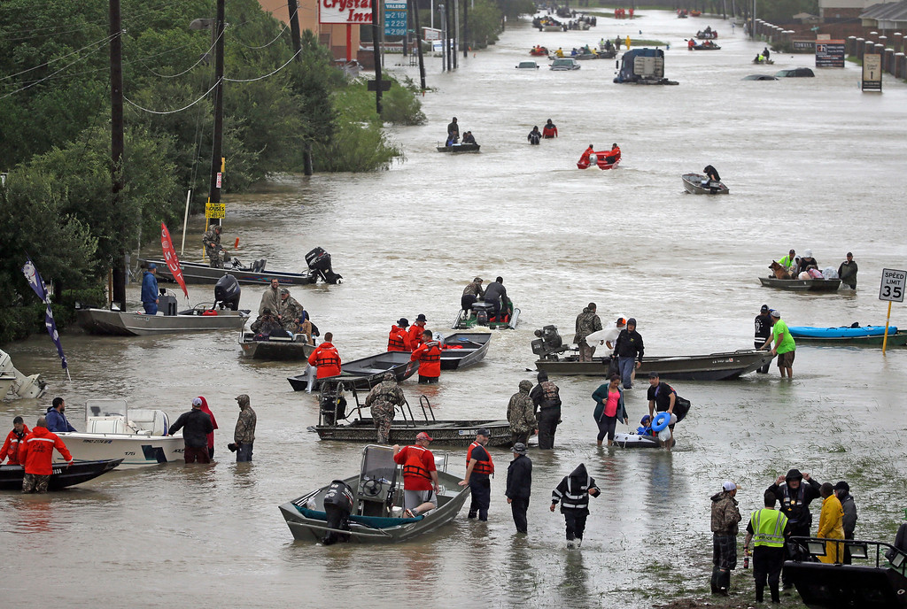 . Rescue boats fill Tidwell Road as they help flood victims evacuate as floodwaters from Tropical Storm Harvey rise Monday, Aug. 28, 2017, in Houston. (AP Photo/David J. Phillip)