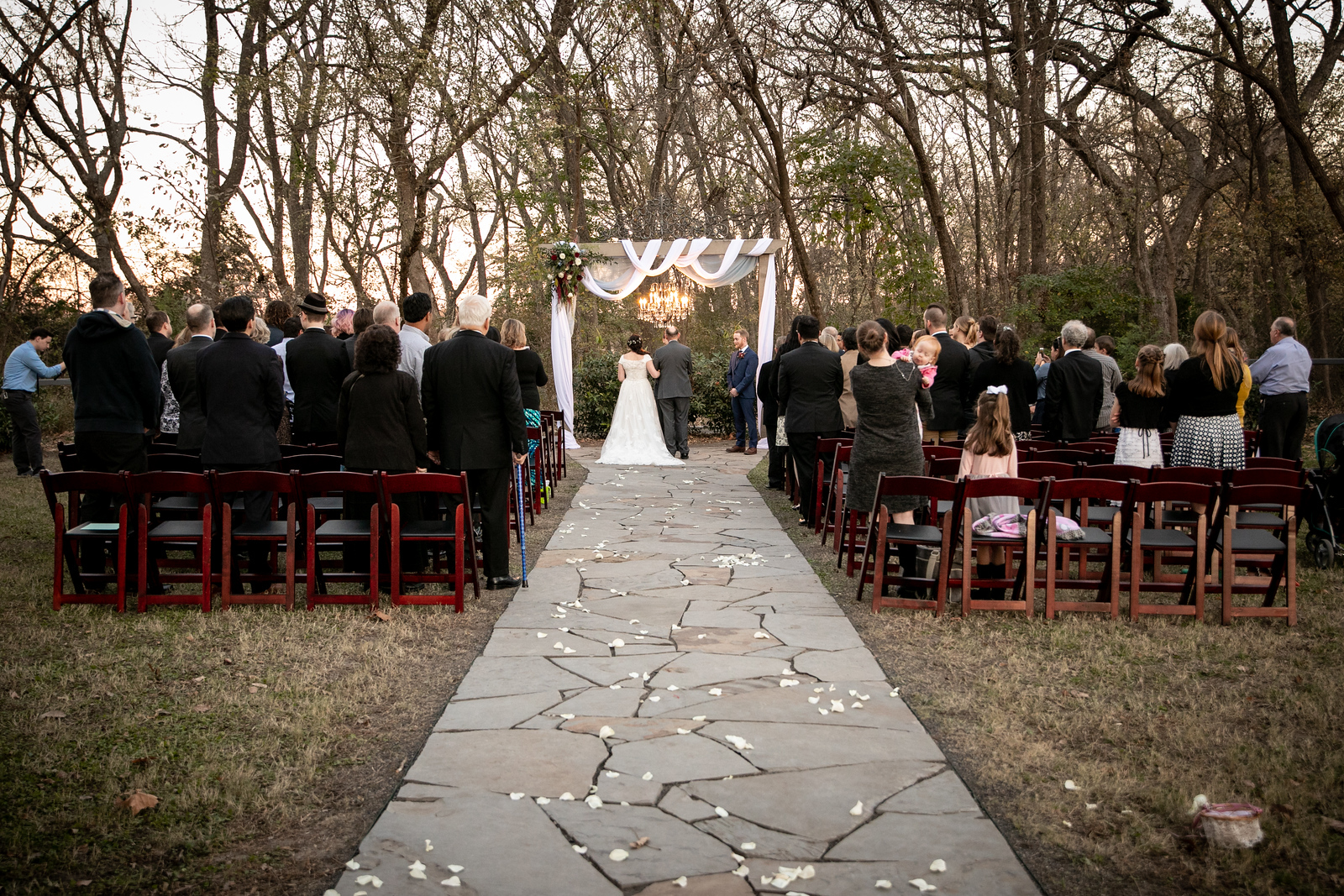 outdoor wedding ceremony on a fall Texas evening