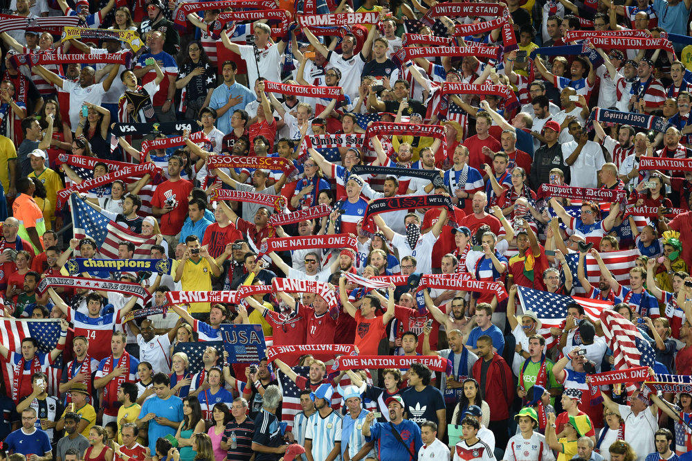 Description of . US fans cheer before before the Group G football match between Ghana and US at the Dunas Arena in Natal during the 2014 FIFA World Cup on June 16, 2014.   JAVIER SORIANO/AFP/Getty Images
