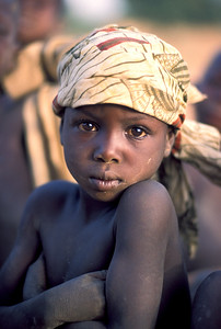 A young girl from West Africa with big eyes.  Photo by Jim Whitmer
