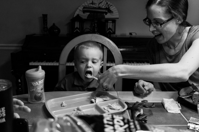Mother feeding child dinner.JPG