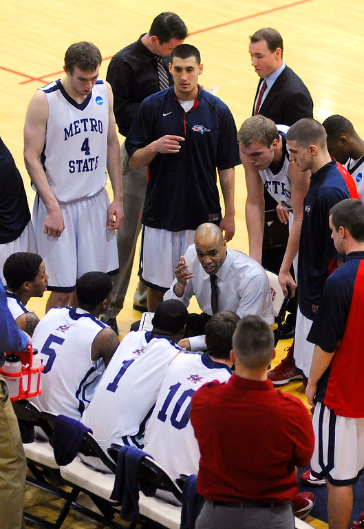 . DENVER, CO. - MARCH 5: Roadrunner\'s coach Derrick Clark had the team\'s attention during a time out in the first half. The Metro State University of Denver men\'s basketball team defeated Colorado Christian University 87-75 Tuesday night, March 5, 2013. (Photo By Karl Gehring/The Denver Post)