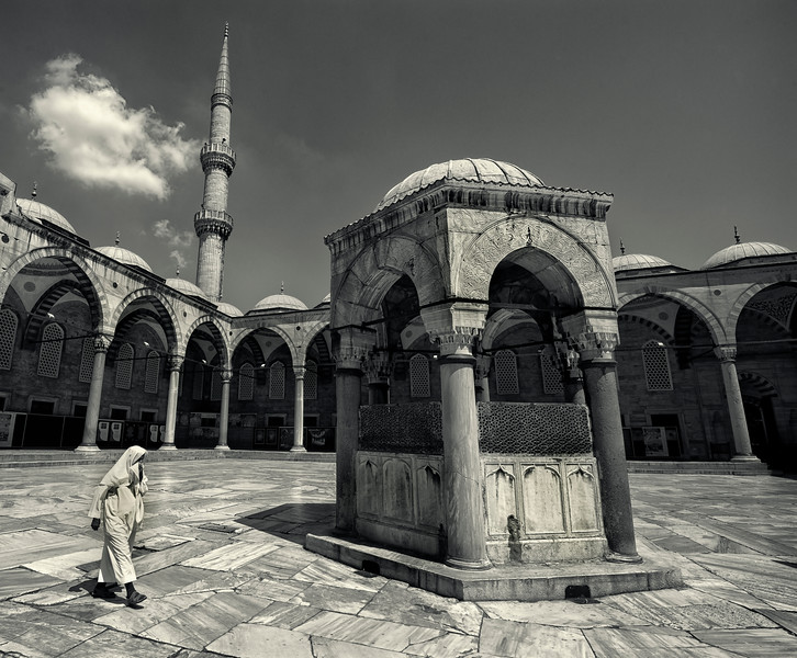 woman going to prayer at the Blue Mosque.  Istanbul, Turkey, 2016