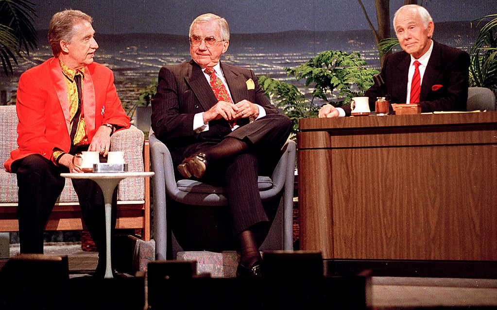 ". FILE - In this Friday, May 22, 1992 file photo, talk show host Johnny Carson, behind his desk, Doc Severinsen, left, leader of ""The Tonight Show Band\"", and announcer Ed McMahon, center, share some moments together during the final taping of the \""Tonight Show\"" in Burbank, Ca. McMahon, the loyal \""Tonight Show\"" sidekick who bolstered boss Johnny Carson with guffaws and a resounding \""H-e-e-e-e-e-ere\'s Johnny!\"" for 30 years, has died at a Los Angeles hospital. He was 86. (AP Photo/Douglas C. Pizac, File)"