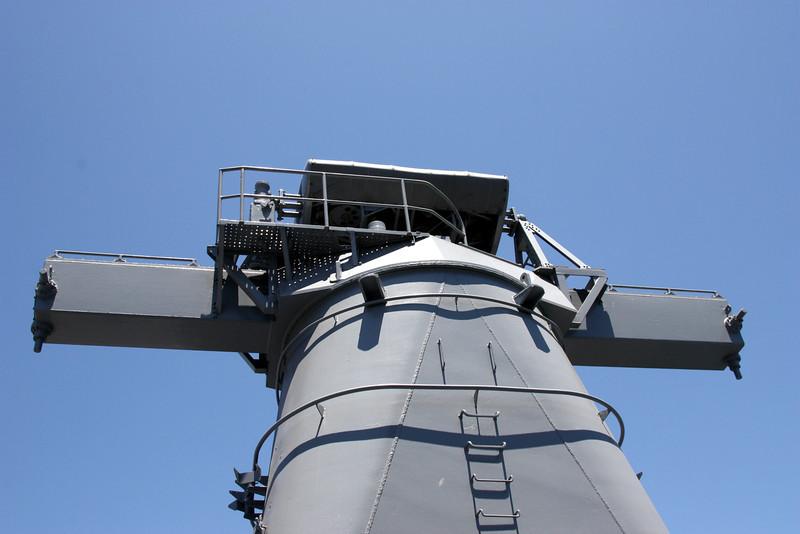 Radar near tail of ship.