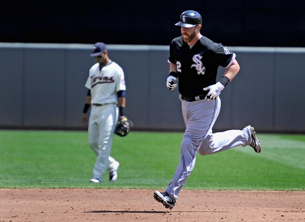 . Chicago\'s Adam Dunn rounds the bases after hitting a two-run home run during the third inning. (Photo by Hannah Foslien/Getty Images)