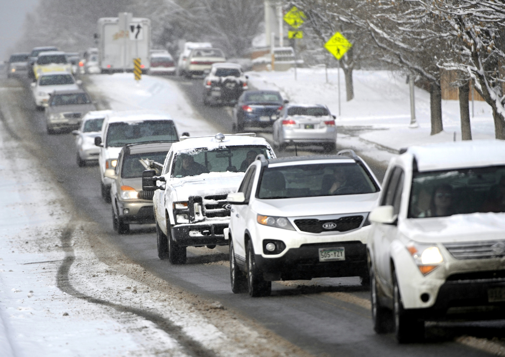 . Commuters make their way down  Yale Ave near Monaco St. in Denver Colorado in the snow Thursday morning,  Feburary 21st, 2013. Andy Cross, The Denver Post