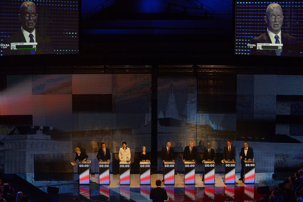 Description of . Presidential candidate Vladimir Franz is seen on a screen as he attends the pre-election\'s TV debate with (L-R) Zuzana Roithova, Jan Fischer, Jana Bobosikova, Tatana Fischerova, Premysl Sobotka, Milos Zeman, Jiri Dientsbier and Karel Schwarzenberg on January 10, 2013 in Prague. The first Czech direct presidential election will be held on January 11-12, 2013.  MICHAL CIZEK/AFP/Getty Images