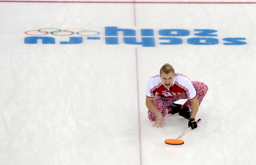 . Russia\'s skip Alexei Stukalskiy shouts at his teammates during the men\'s curling competition against China at the 2014 Winter Olympics, Saturday, Feb. 15, 2014, in Sochi, Russia. (AP Photo/Wong Maye-E)