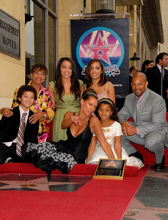 . LOS ANGELES, CA - MARCH 19:  Singer-actress Vanessa Williams (C) is joined by her family as she receives a star on the Hollywood Walk of Fame on March 19, 2007 in Los Angeles, California.  (Photo by Charley Gallay/Getty Images)