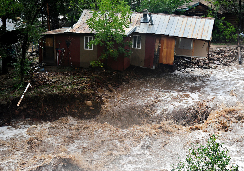 . Flood waters rage along the South St. Vrain River in Lyons Friday, Sept. 13, 2013. (Greg Lindstrom/Times-Call)