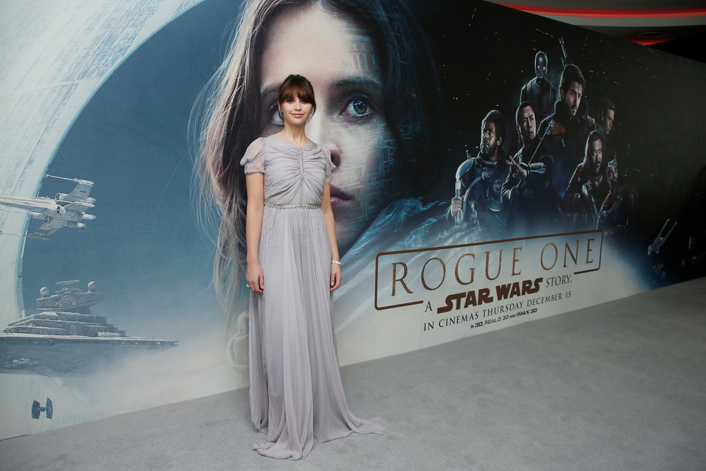 . Felicity Jones poses for photographers upon arrival at the Rogue One: A Star Wars Story fan screening in London, Tuesday, Dec. 13, 2016. (Photo by Joel Ryan/Invision/AP)