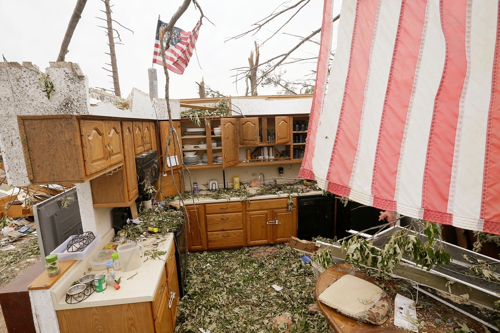 . Flags fly over two walls that remain of a house in Mayflower, Ark., Tuesday, April 29, 2014.  On Sunday evening, roughly 15 tornadoes carved a path of destruction in the South and the country\'s midsection, according to estimates from the National Oceanic and Atmospheric Administration\'s Storm Prediction Center. On Monday, around 50 tornadoes ravaged the South, the agency said.  (AP Photo/Danny Johnston)