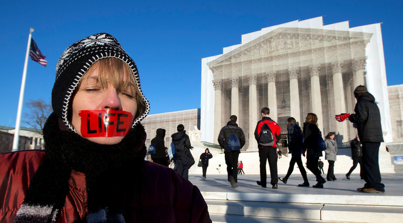 . Anti-abortion activist, Jenese English, voices her opinion in front of the U.S. Supreme Court in Washington, Tuesday, Jan. 22, 2013 coinciding with the 40th anniversary of Roe v. Wade, the Supreme Court decision that legalized abortion.   (AP Photo/Manuel Balce Ceneta)