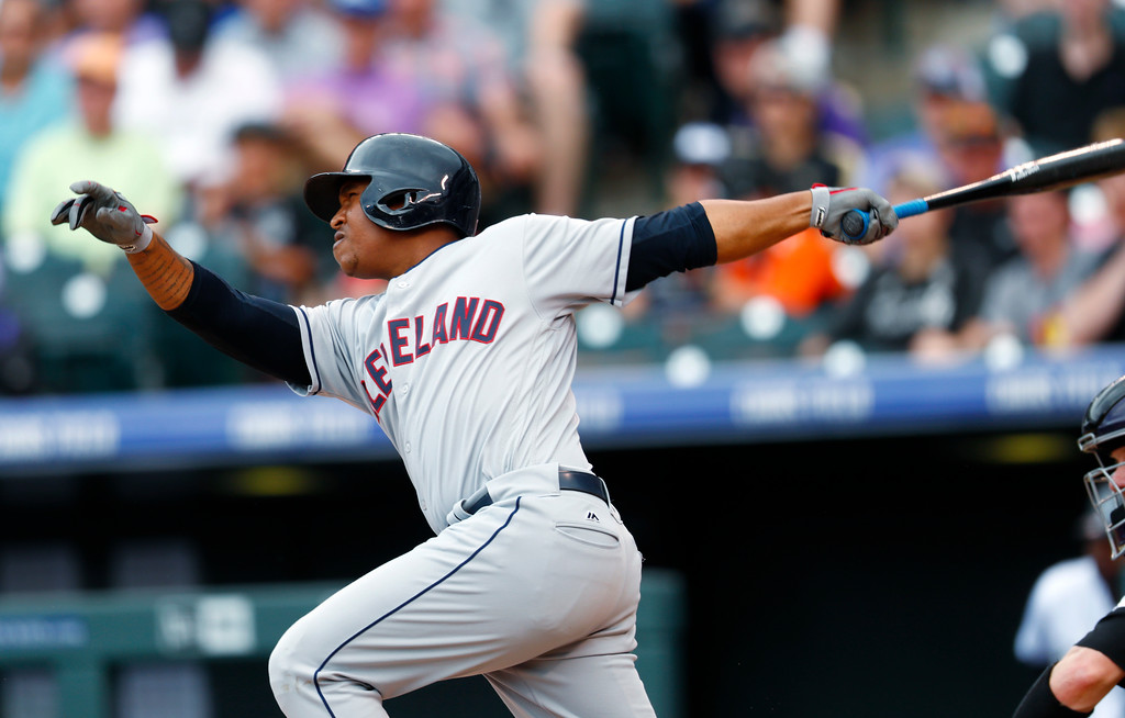. Cleveland Indians\' Jose Ramirez watches his solo home run off Colorado Rockies starting pitcher Kyle Freeland during the seventh inning of a baseball game Wednesday, June 7, 2017, in Denver. Colorado won 8-1. (AP Photo/David Zalubowski)
