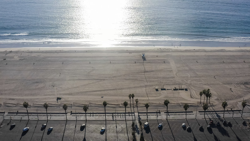 Aerial view of California's Santa Monica beach and parking lot on the Pacific Ocean - Ocean Park, Santa Monica, California, United States (US)