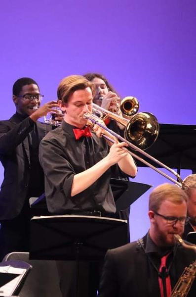 Refuss playing his trombone.