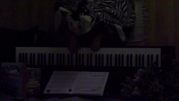 A strange zebra-boy plays piano