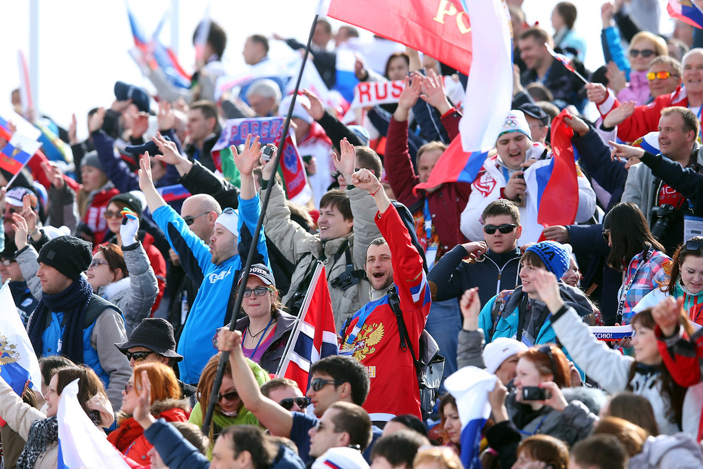 . Fans celebrate during the Men\'s 50 km Mass Start Free during day 16 of the Sochi 2014 Winter Olympics at Laura Cross-country Ski & Biathlon Center on February 23, 2014 in Sochi, Russia.  (Photo by Julian Finney/Getty Images)