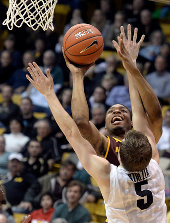 . Colorado\'s Eli Stalzer plays defense on Jermaine Marshall during a game against Arizona State on Wednesday, Feb. 19, in Broomfield, Colorado. Jeremy Papasso/Boulder Daily Camera