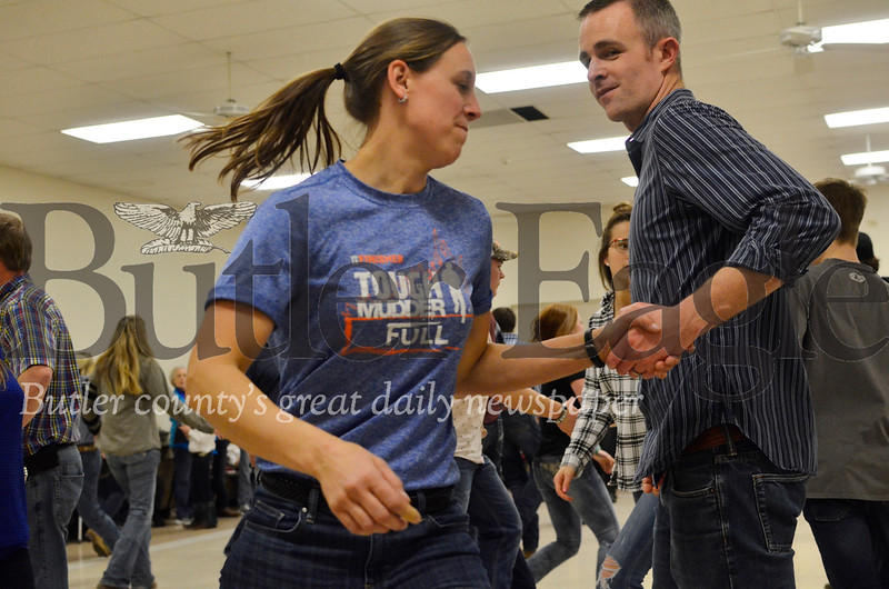 Casey Unverzagt, right, swings Liz Witmer at the Harrisville Volunteer Fire Company's January square dance. Tanner Cole/Butler Eagle