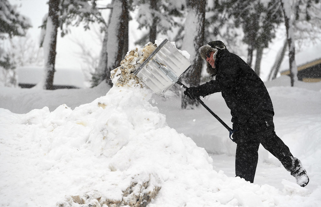 . NEDERLAND, CO - APRIL 17: Robert Painter shovels heavy wet snow out of his driveway on April 17, 2016 in Nederland, Colorado. A slow moving spring storm dumped almost 3 feet of snow in the foothills.  (Photo by Helen H. Richardson/The Denver Post)