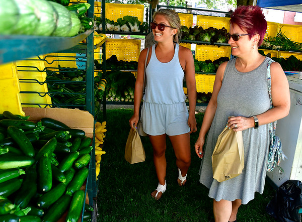 7/5/2019 Mike Orazzi | Staff Annalisa Sega and her mother Chris Bailey while shopping at the Southington Farmers' Market on the town green Friday.