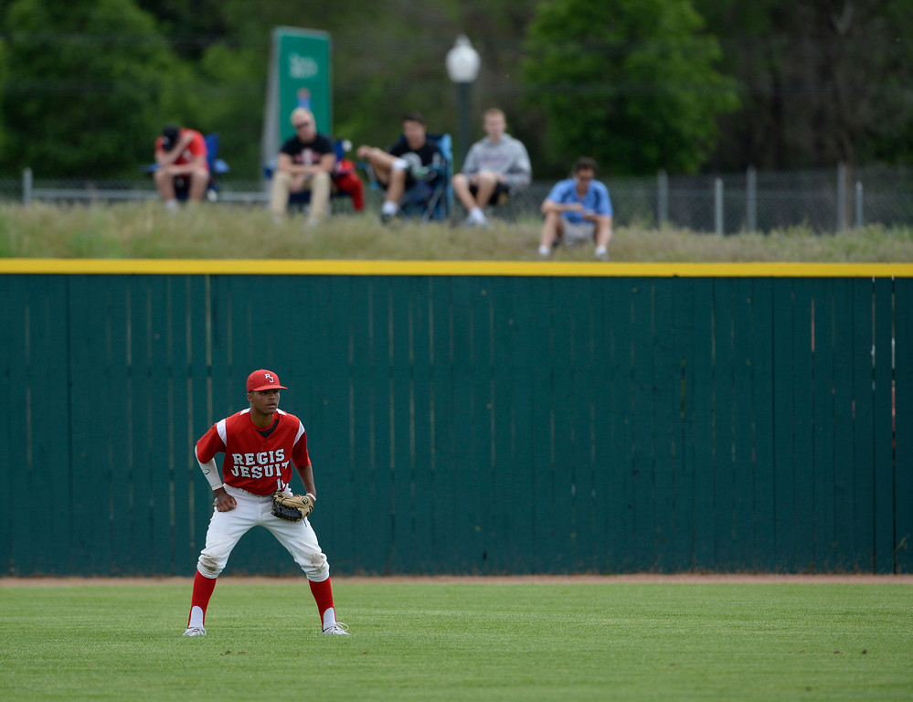 . DENVER, CO. - MAY 23: Regis outfielder, Quin Cotton, during action against Mountain Vista with fans along a berm outside of All City Field during the Colorado State 5A baseball playoffs at All City Field Friday afternoon, May 23, 2014. (Photo By Andy Cross / The Denver Post)