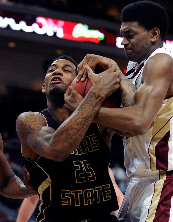 . Texas State\'s Joel Wright (25) and Denver\'s Cam Griffin fight over the ball during the fist half of a Western Athletic Conference tournament NCAA college basketball game on Thursday, March 14, 2013, in Las Vegas. (AP Photo/David Becker)
