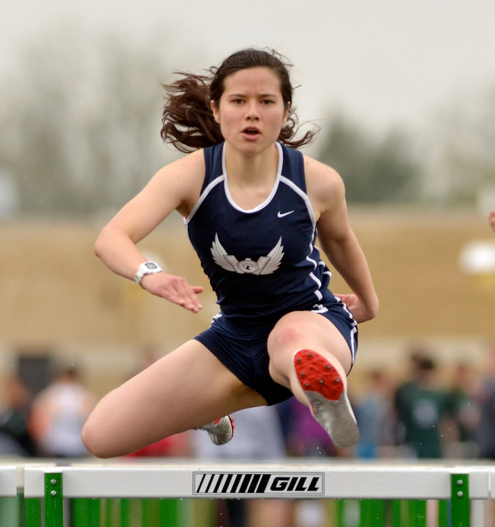 . Jeff Forman/JForman@News-Herald.com Lilly Faulk, West Geuaga, competes in the 100 meter hurdle during the Mayfield 2014 Track and Field Invitaional May 9 at Mayfield High School.
