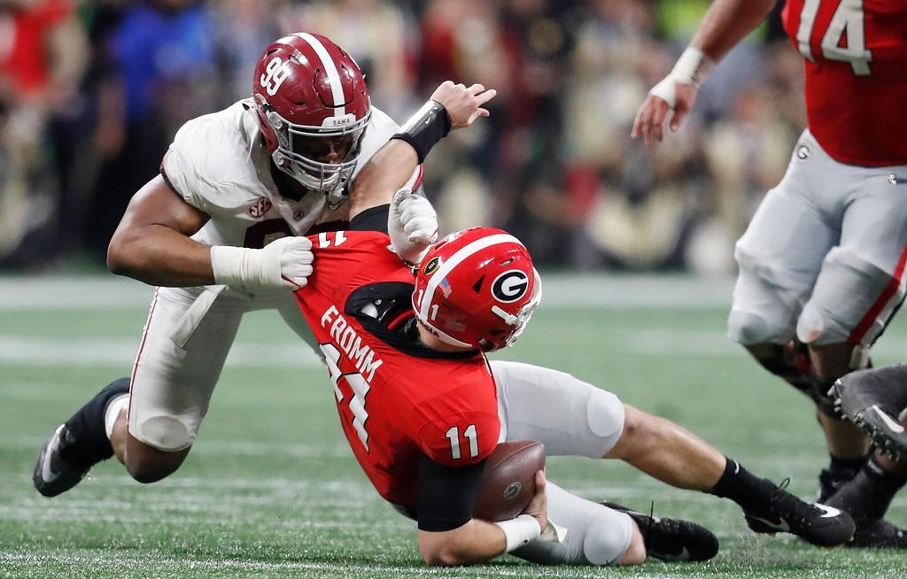 . Alabama\'s Raekwon Davis sacks Georgia\'s Jake Fromm during the second half of the NCAA college football playoff championship game Monday, Jan. 8, 2018, in Atlanta. (AP Photo/David Goldman)