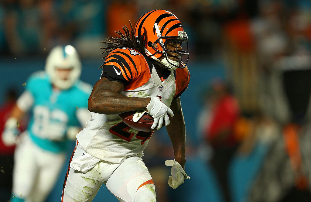 . Adam Jones #24 of the Cincinnati Bengals recovers a fumble during a game against the Miami Dolphins at Sun Life Stadium on October 31, 2013 in Miami Gardens, Florida.  (Photo by Mike Ehrmann/Getty Images)