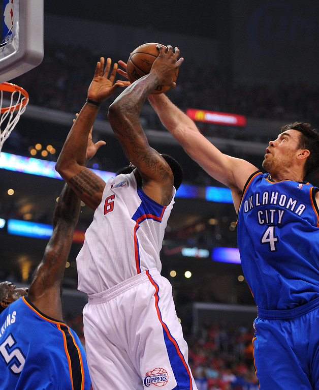 . The Thunder\'s Nick Collison blocks a shot by the Clippers\' DeAndre Jordan, Friday, May 9, 2014, at Staples Center. (Photo by Michael Owen Baker/Los Angeles Daily News)