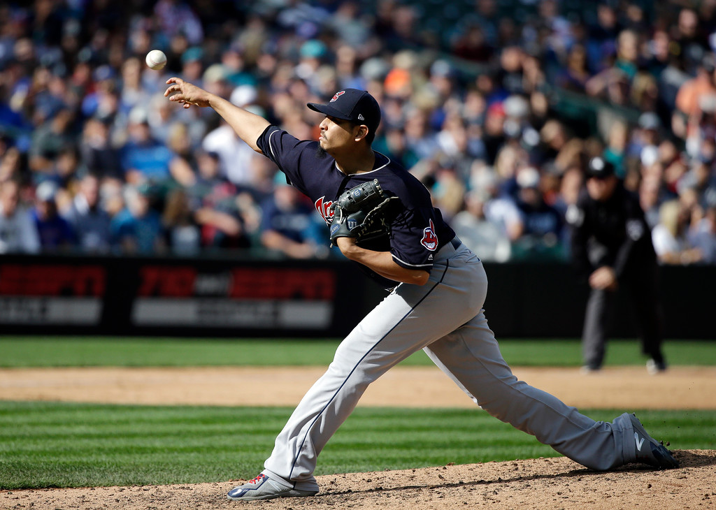 . Cleveland Indians starting pitcher Carlos Carrasco throws against the Seattle Mariners in a baseball game Saturday, Sept. 23, 2017, in Seattle. (AP Photo/Elaine Thompson)