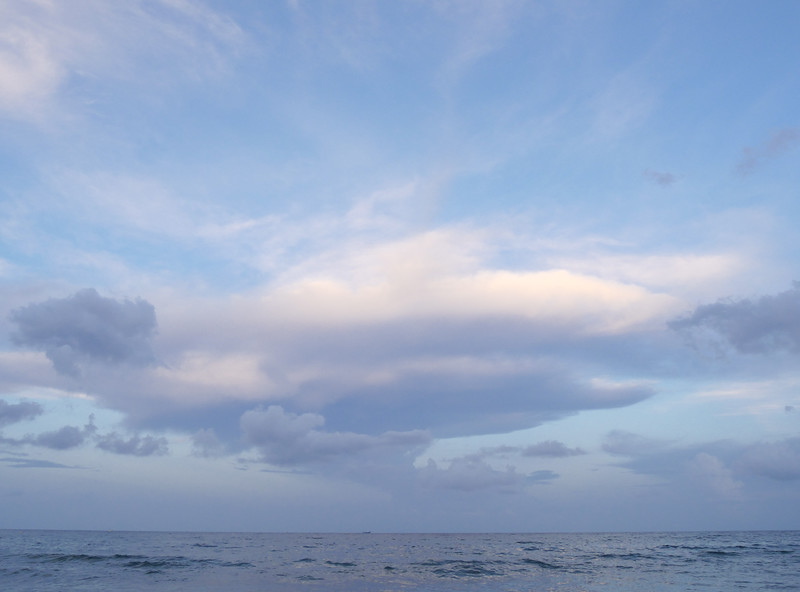 july beach clouds