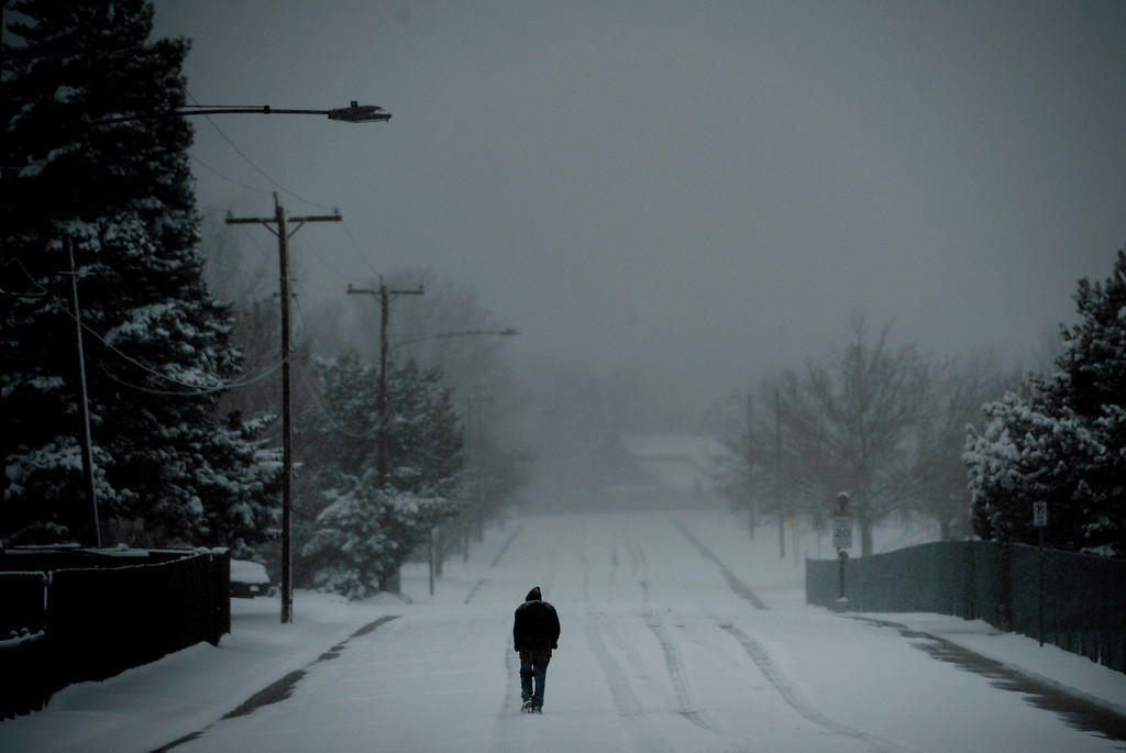 . LITTLETON, CO. - MARCH 23: Tom Roe makes his way down W. Euclid Ave in Littleton, CO March 23, 2013. The Saturday forecast calls for snow accumulation of 9 to 12 inches with highs in the lower to mid 20s. (Photo By Craig F. Walker/The Denver Post)